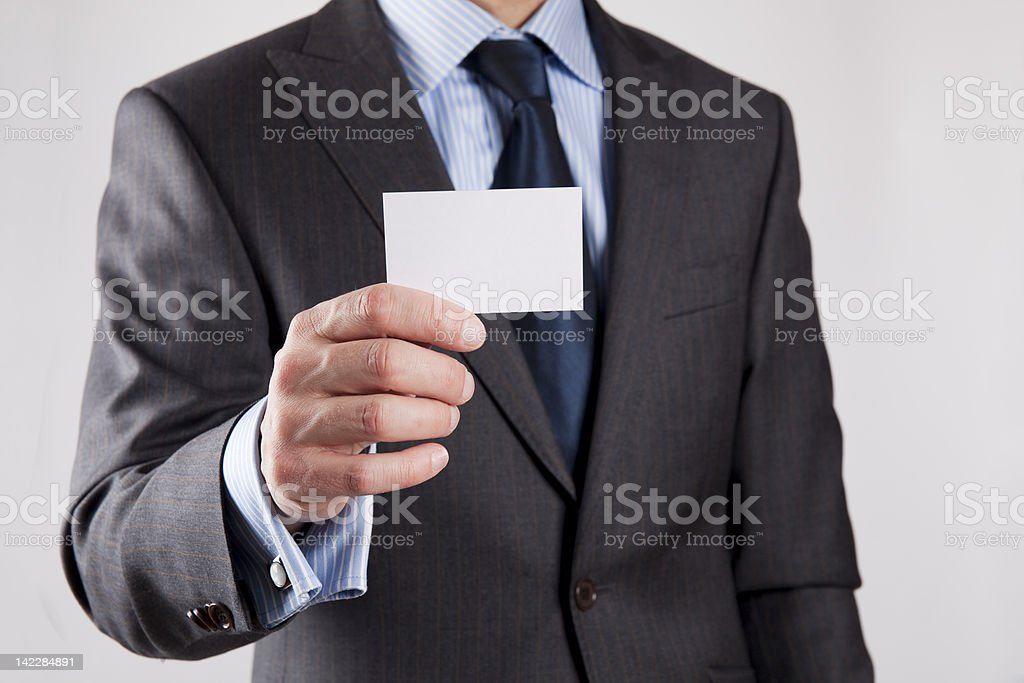 Businessman shows business card stock photo