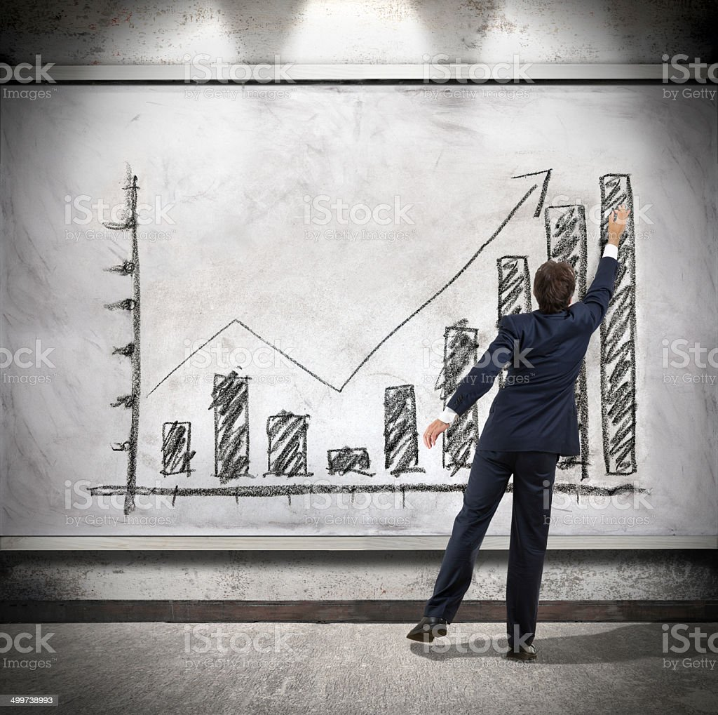Businessman shows economic growth stock photo