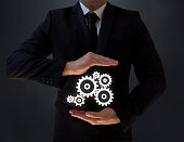 Businessman Shows Industrial Gears