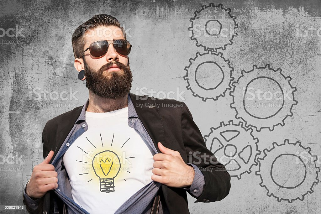 businessman shows the symbol of idea on shirt stock photo