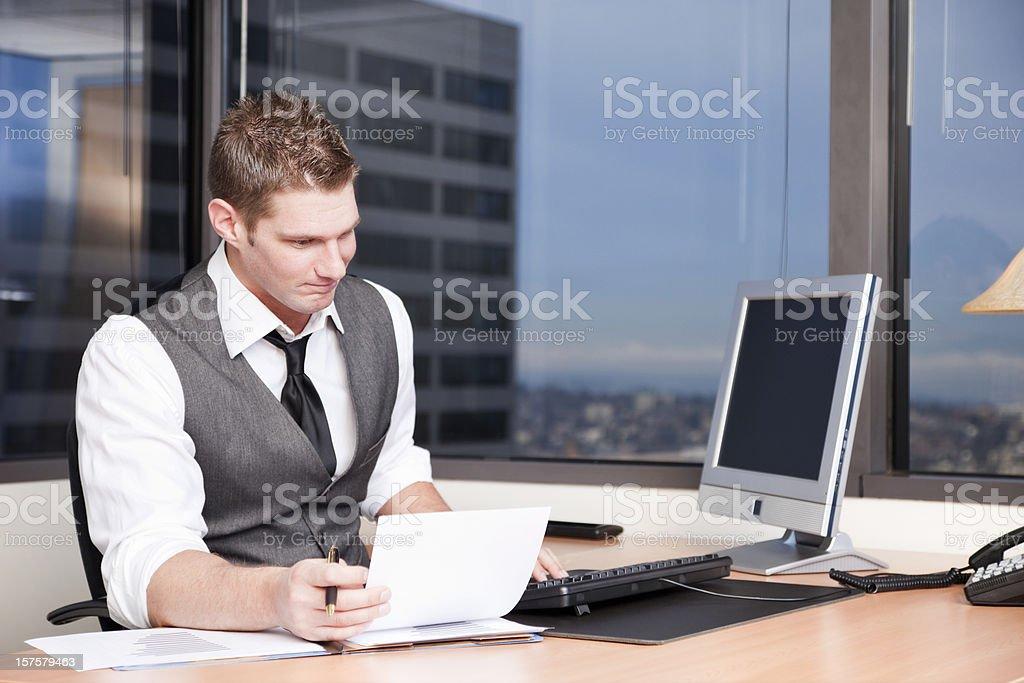 Businessman Shuffling Paperwork royalty-free stock photo