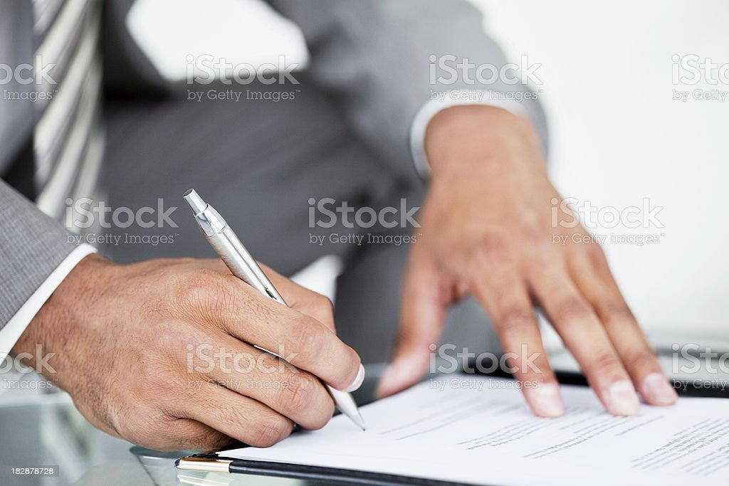 Businessman Signing a Document royalty-free stock photo