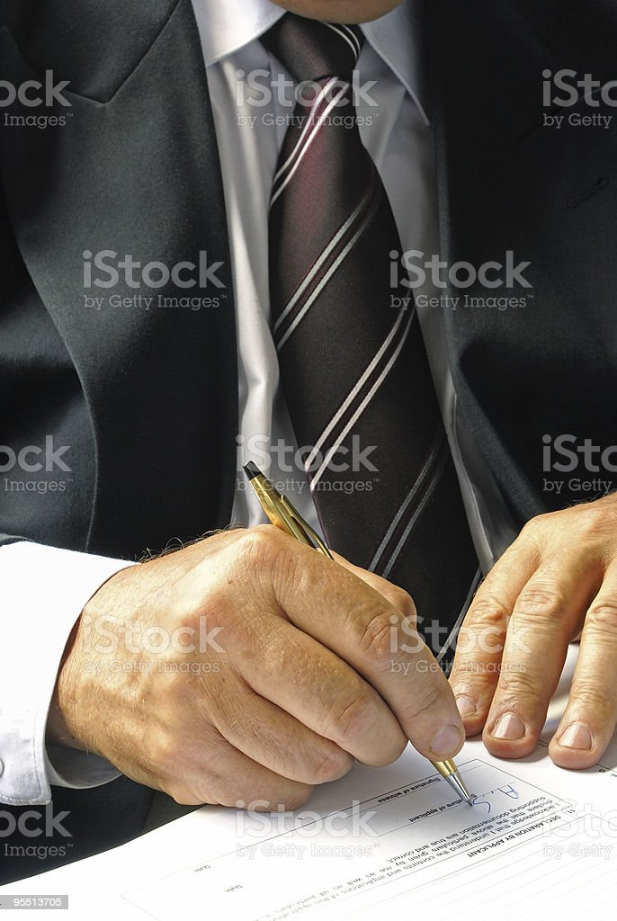 Businessman signing a form royalty-free stock photo