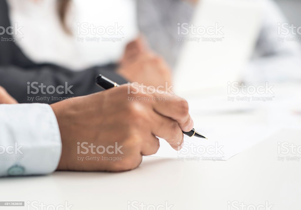 Businessman Signing Annual Report stock photo