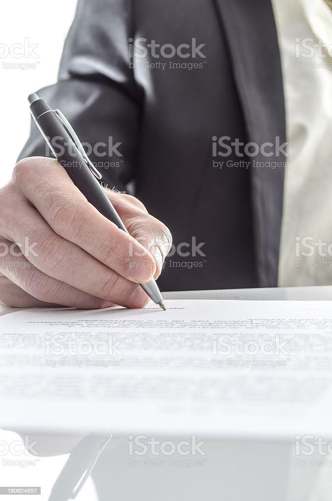 Businessman signing closeup stock photo