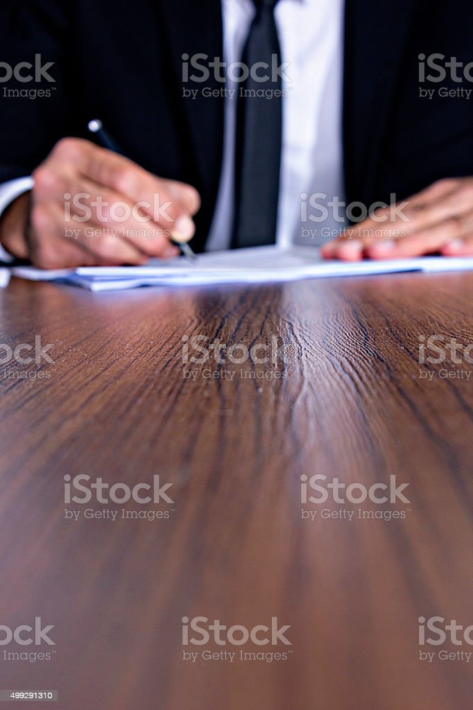 Businessman Signing Contract Paper stock photo