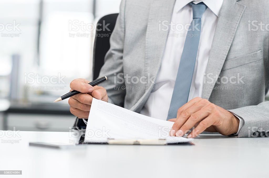 Businessman signing contract stock photo