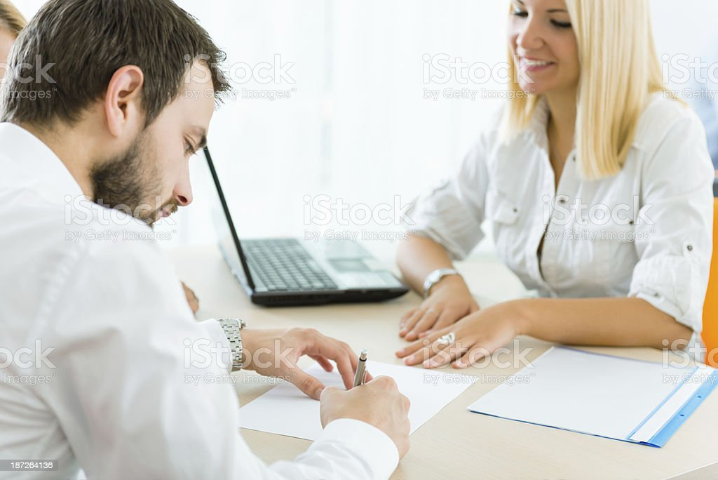 Businessman signing contractual documents royalty-free stock photo