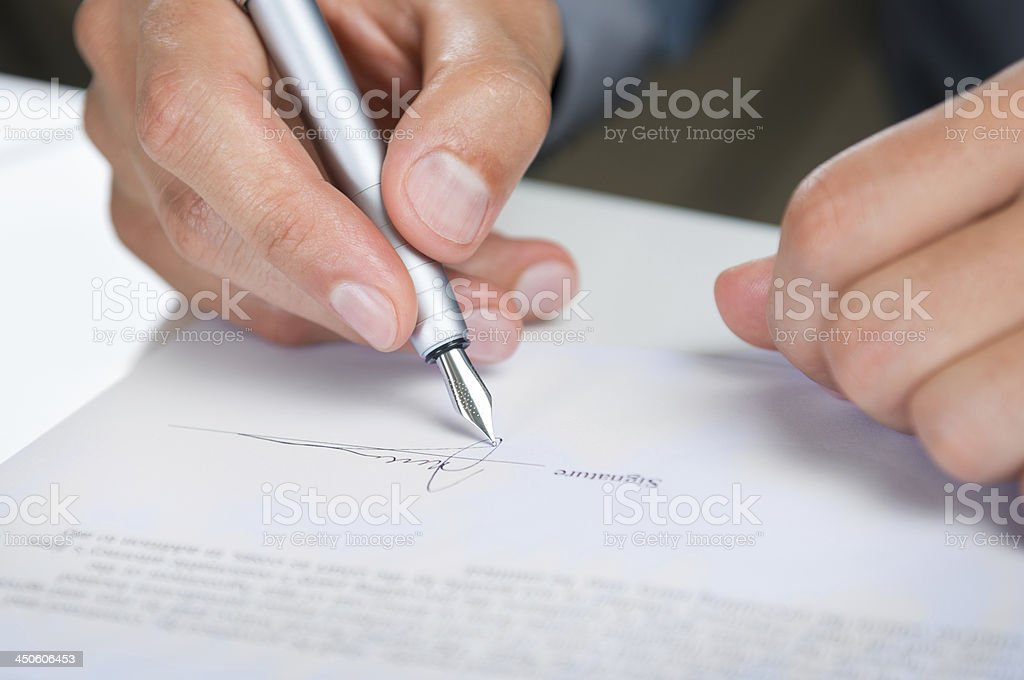 Businessman Signing Document stock photo