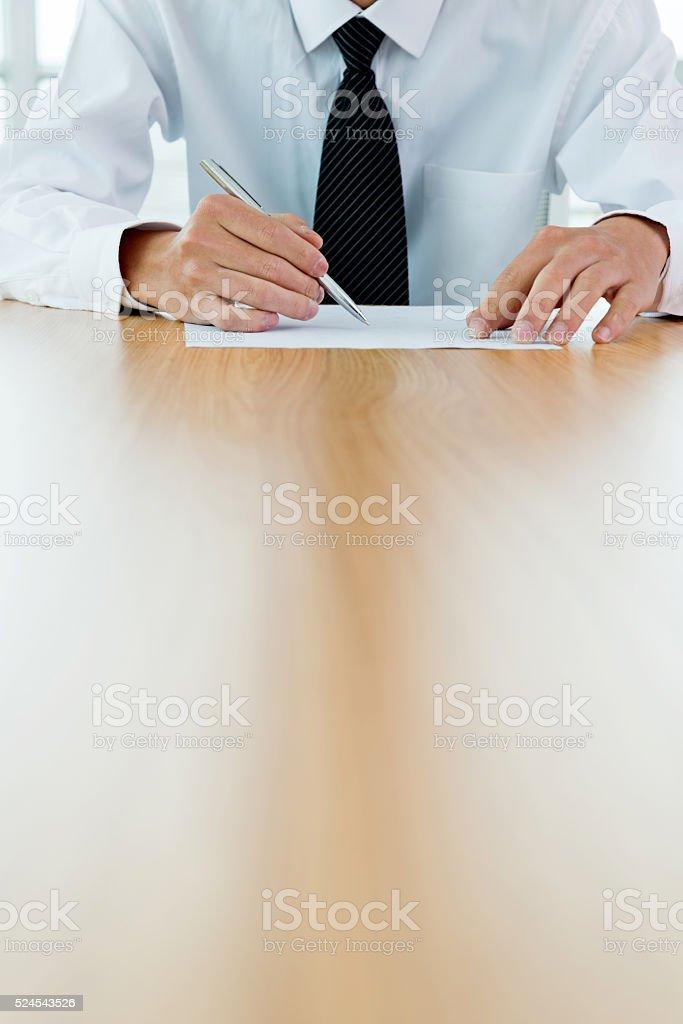 Businessman signing on document stock photo