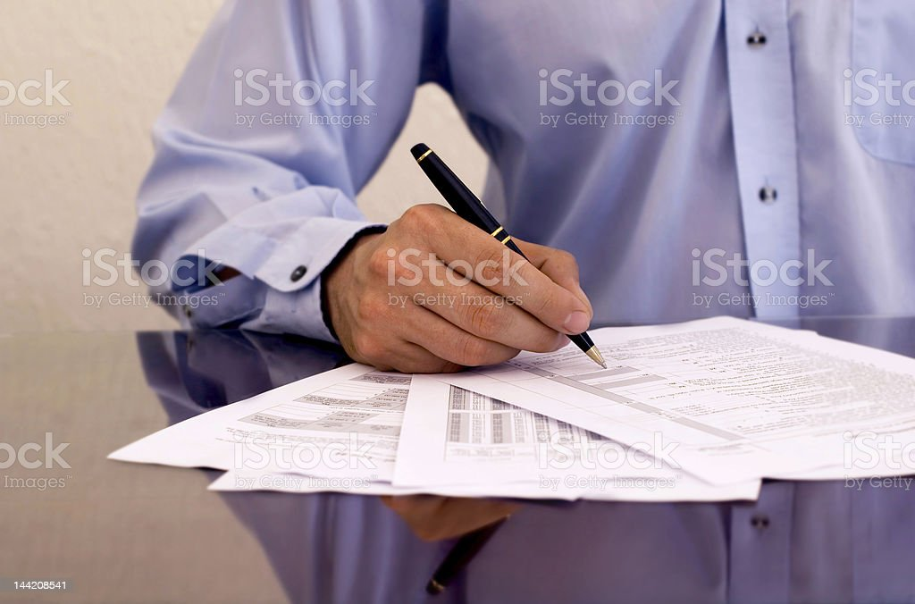 businessman signing papers royalty-free stock photo