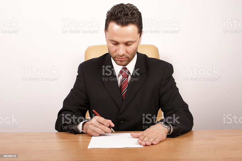 Businessman signing the paper royalty-free stock photo