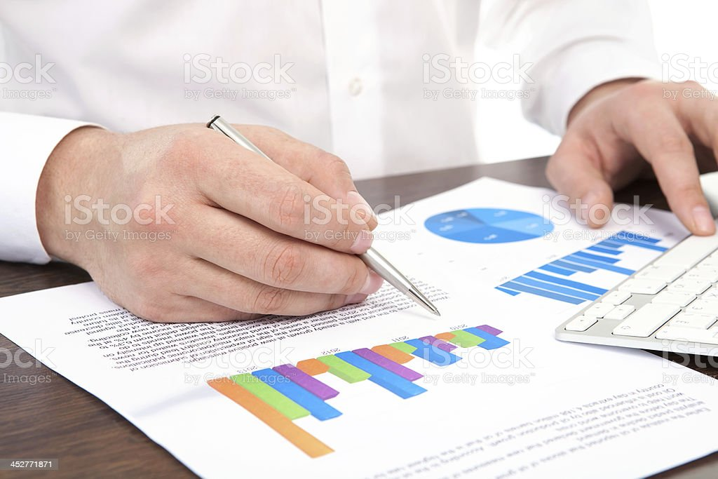 businessman signs a document at the desk in office royalty-free stock photo