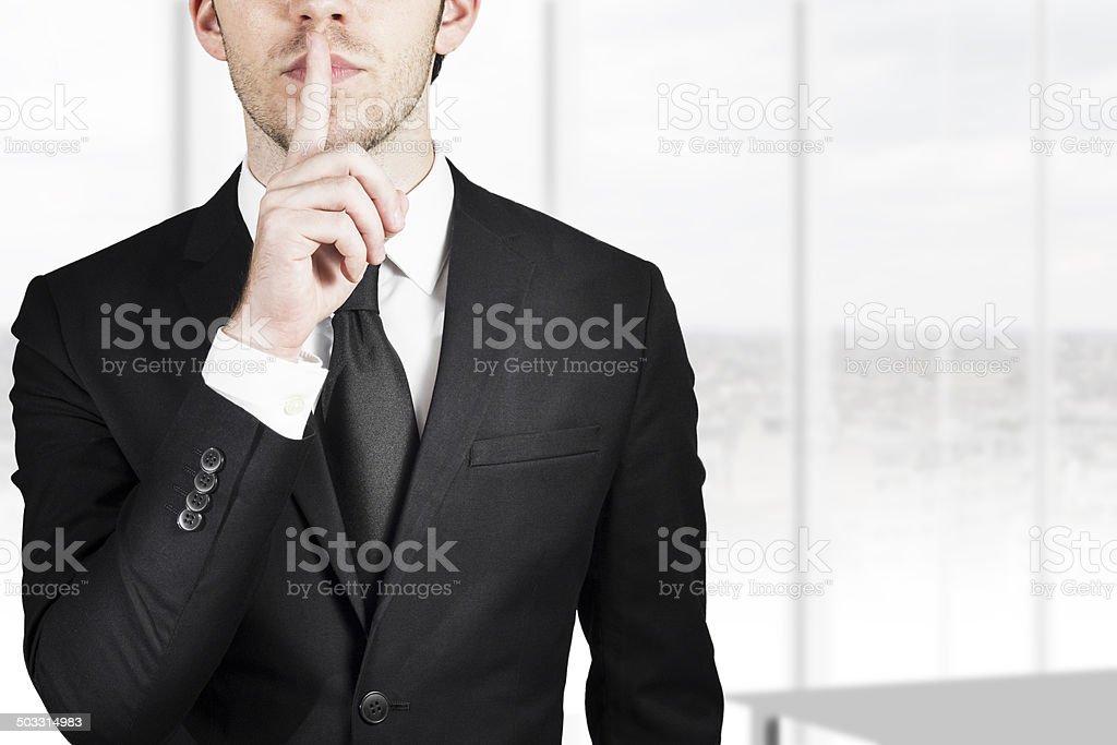 businessman silent quiet gesture stock photo