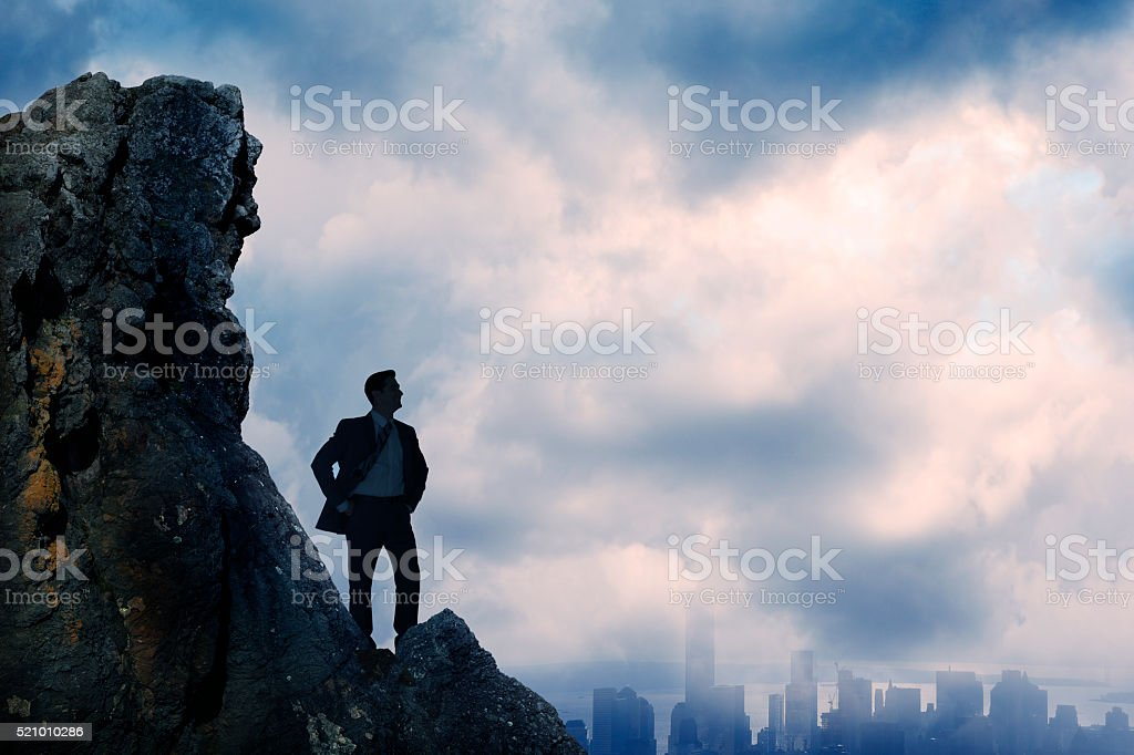 Businessman Silhouetted As He Confidently Looks Over City stock photo
