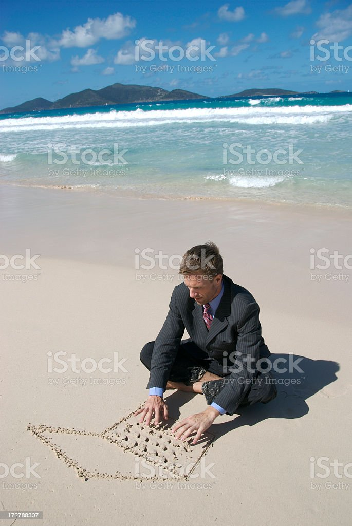 Businessman Sits Tropical Beach Typing on Sand Laptop stock photo