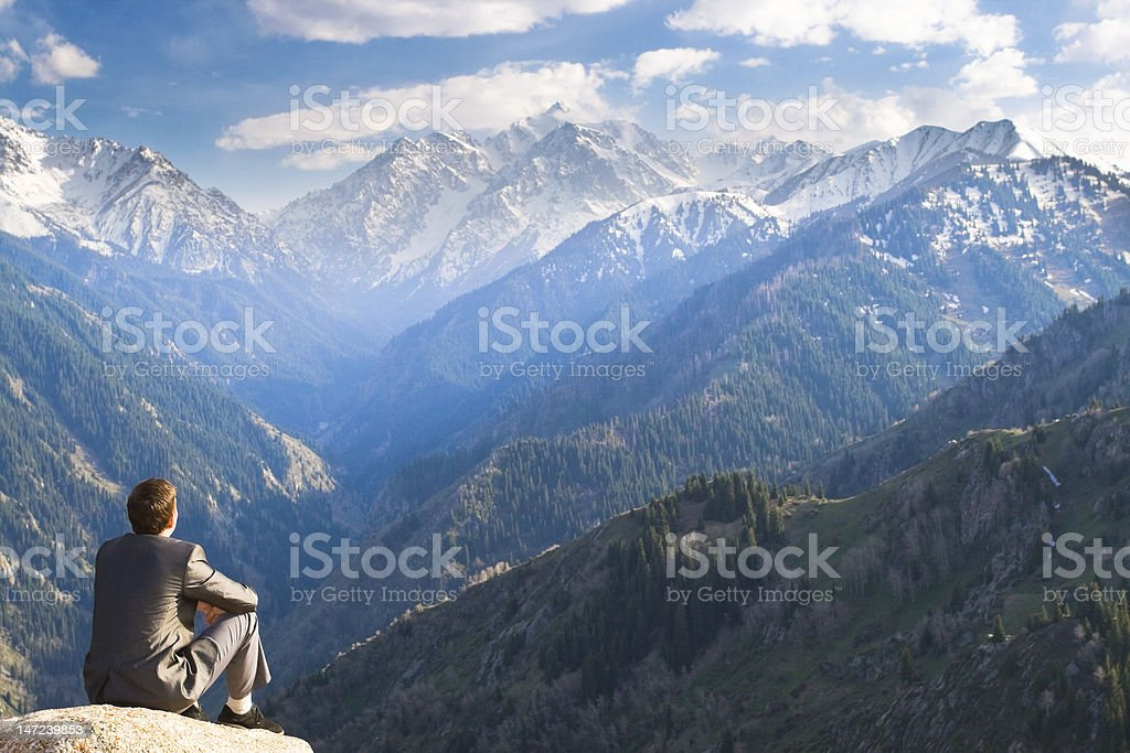 Businessman sitting and thinking about future plans stock photo