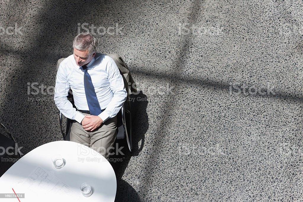 Businessman sitting at conference room stock photo