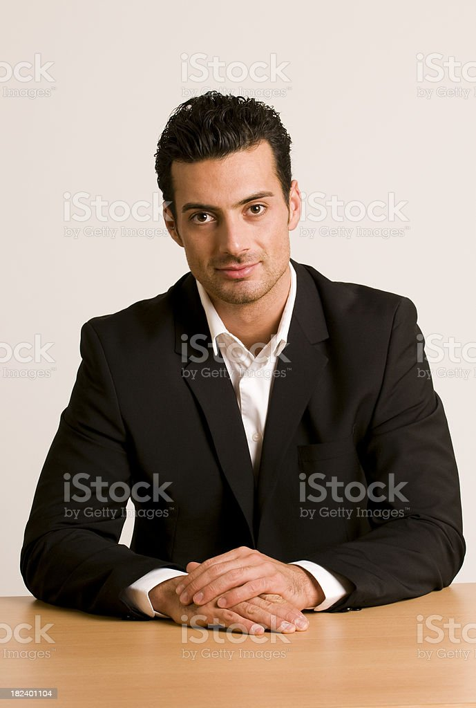 businessman sitting at desk royalty-free stock photo