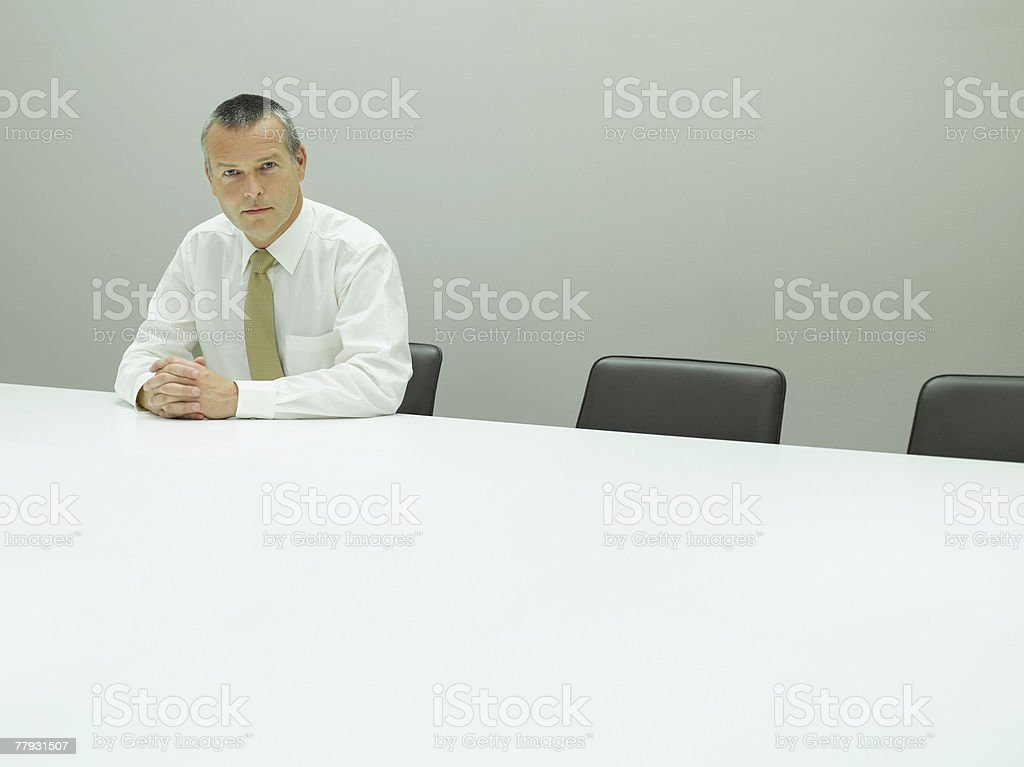 Businessman sitting at table in office royalty-free stock photo