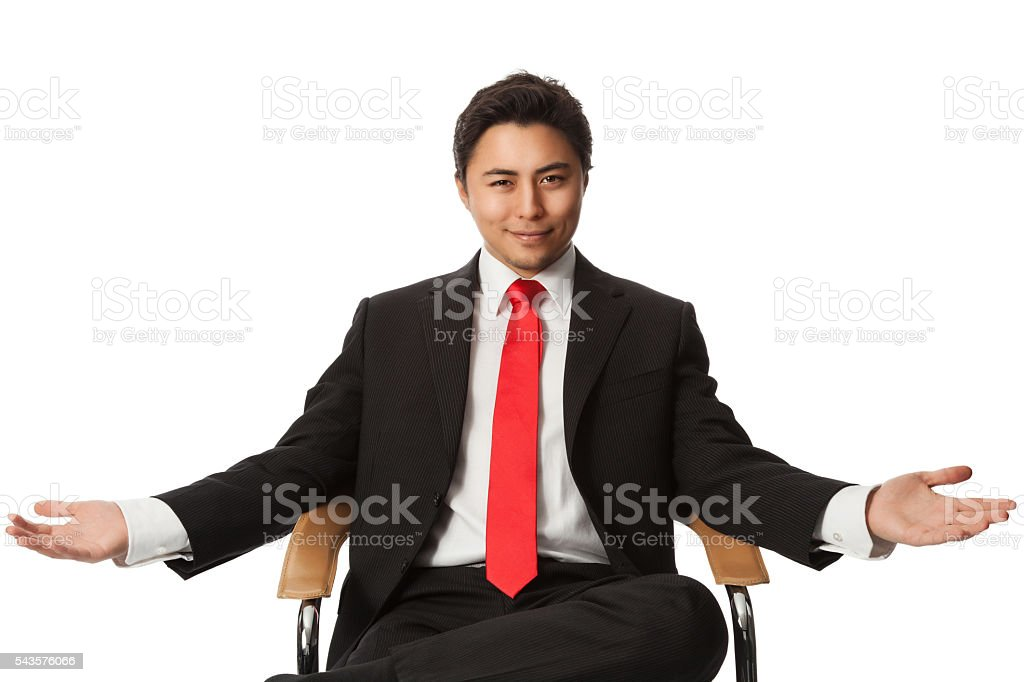 Businessman sitting down stock photo