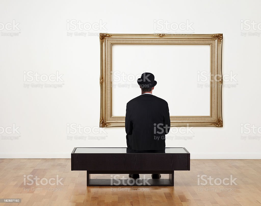 Businessman Sitting in a Art Gallery stock photo
