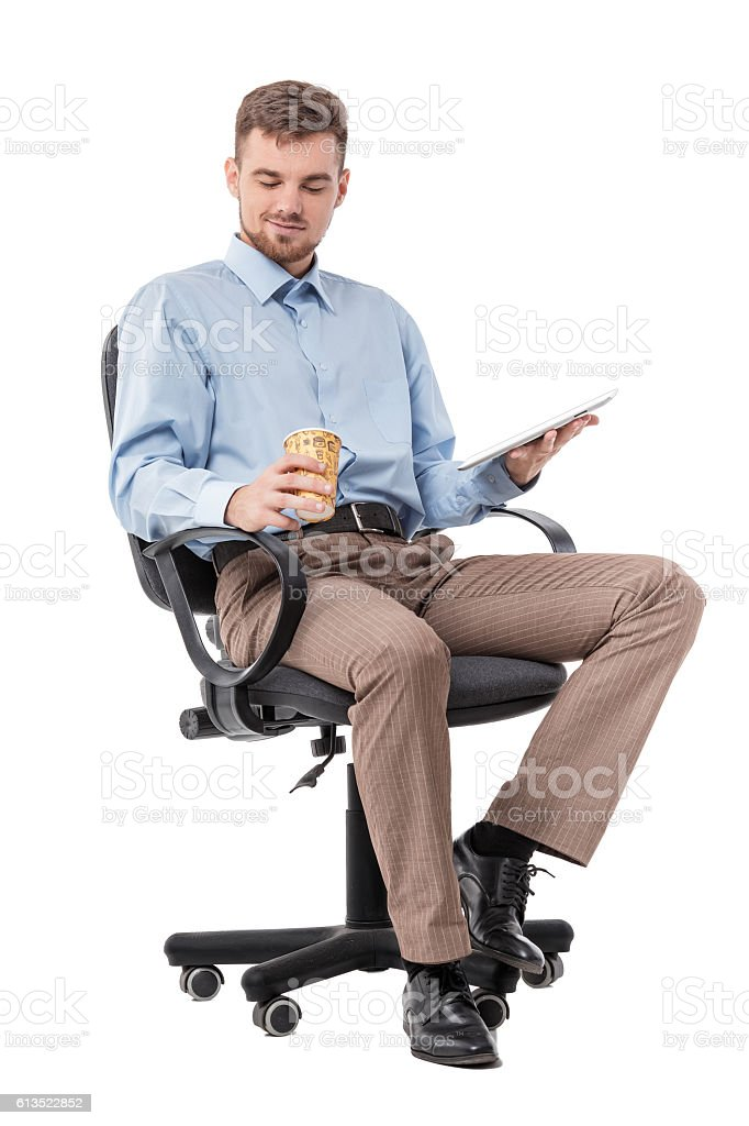 businessman sitting in a office chair and drinking coffee stock photo