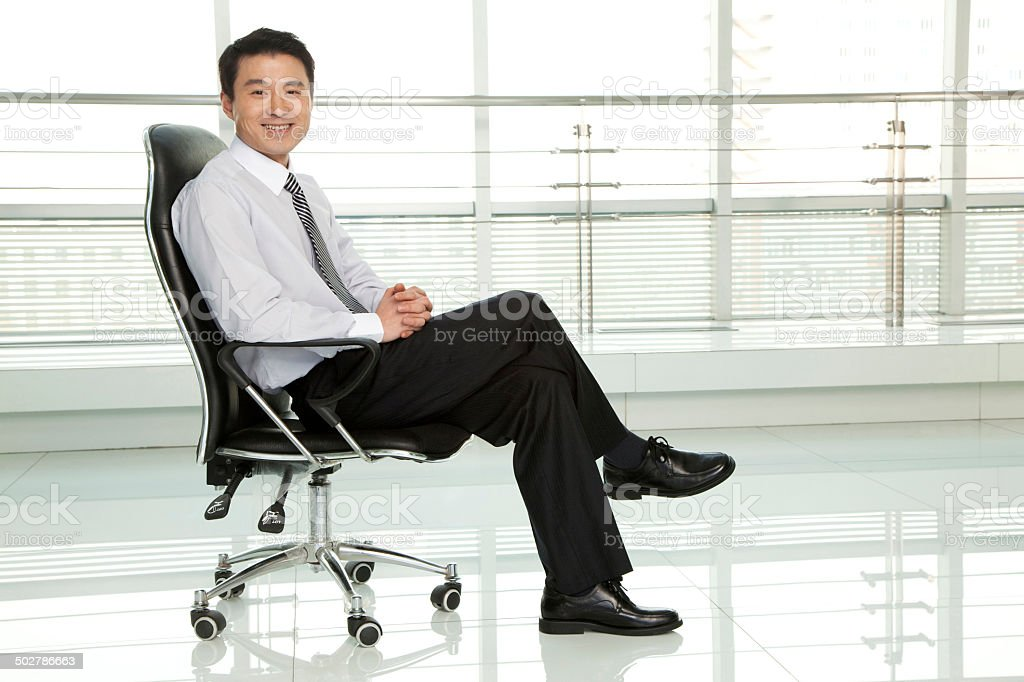 Businessman Sitting in Chair stock photo