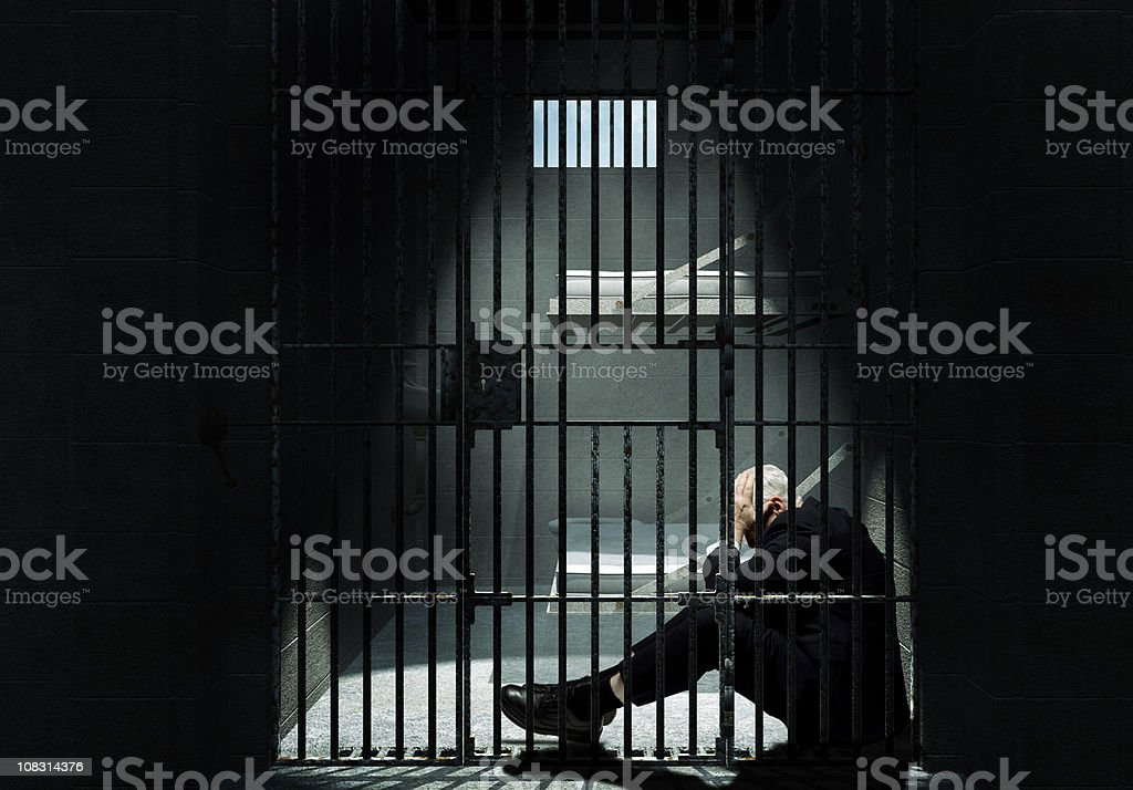 Businessman sitting in Jail stock photo