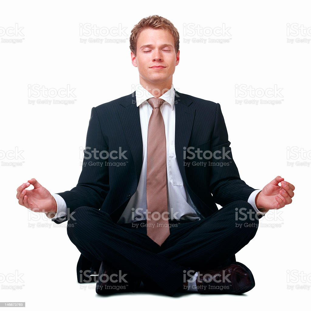 Businessman sitting in lotus position against white background royalty-free stock photo