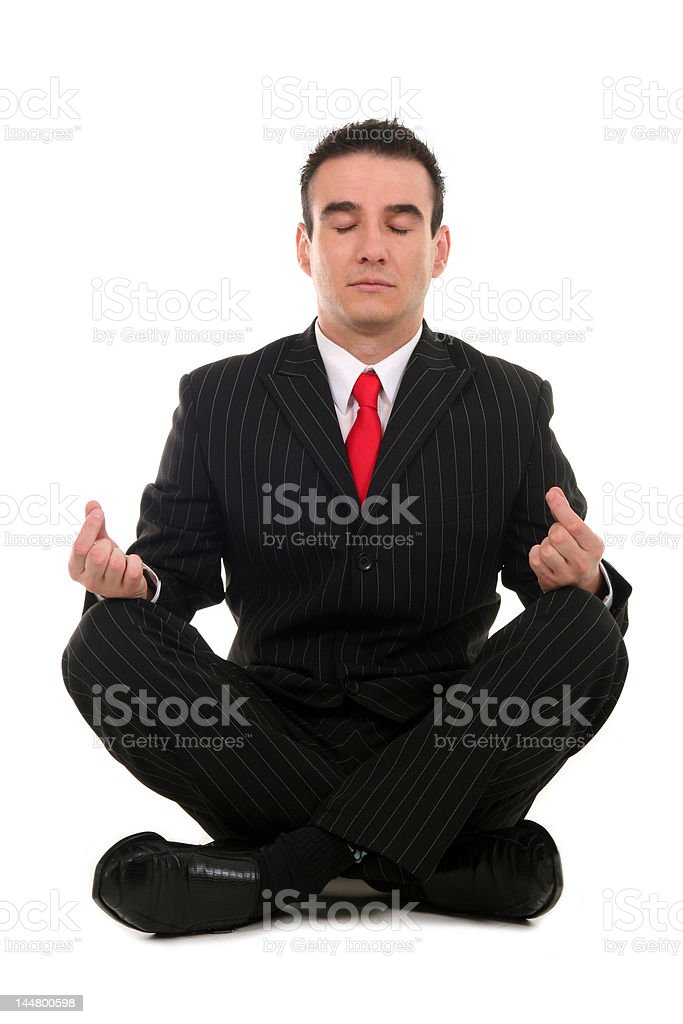 Businessman sitting in lotus position royalty-free stock photo