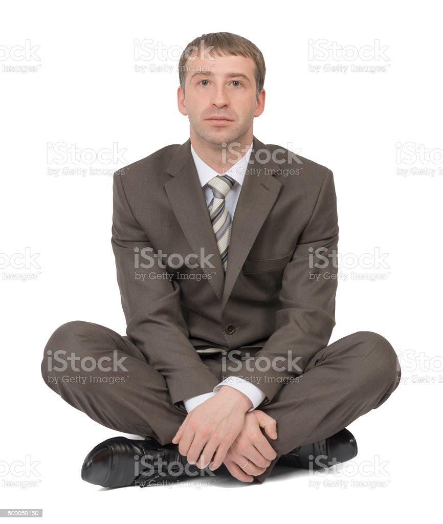 Businessman sitting in lotus posture stock photo