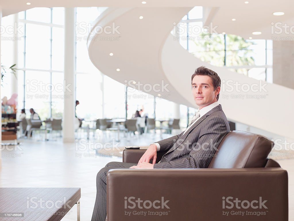 Businessman sitting in office waiting area royalty-free stock photo