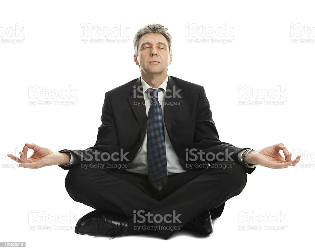 Businessman sitting in yoga position royalty-free stock photo