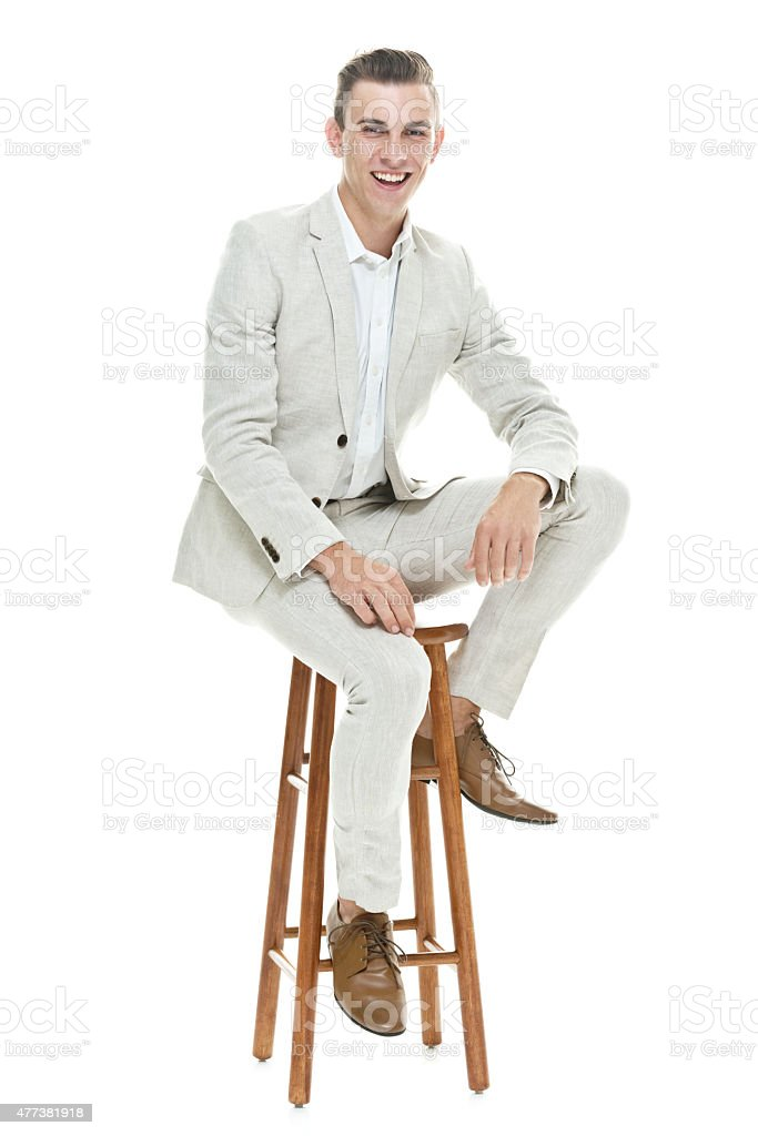 Businessman sitting on stool stock photo