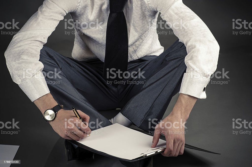businessman sitting on the floor royalty-free stock photo