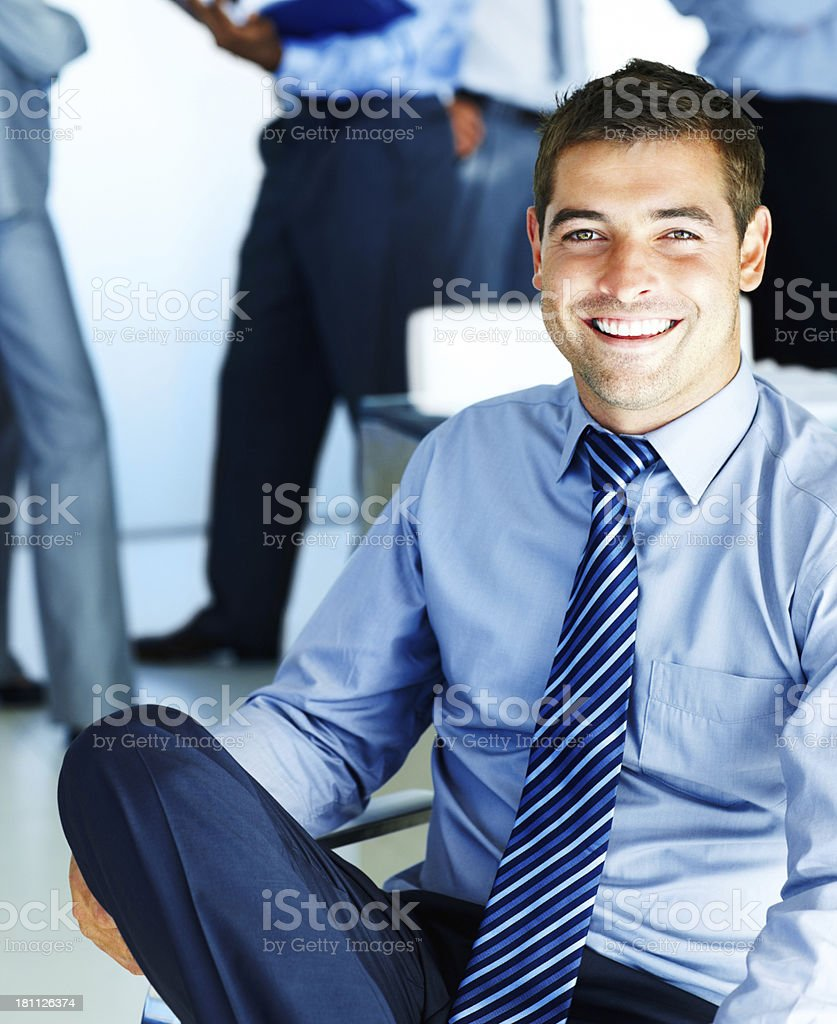 Businessman sitting with colleague in the background royalty-free stock photo
