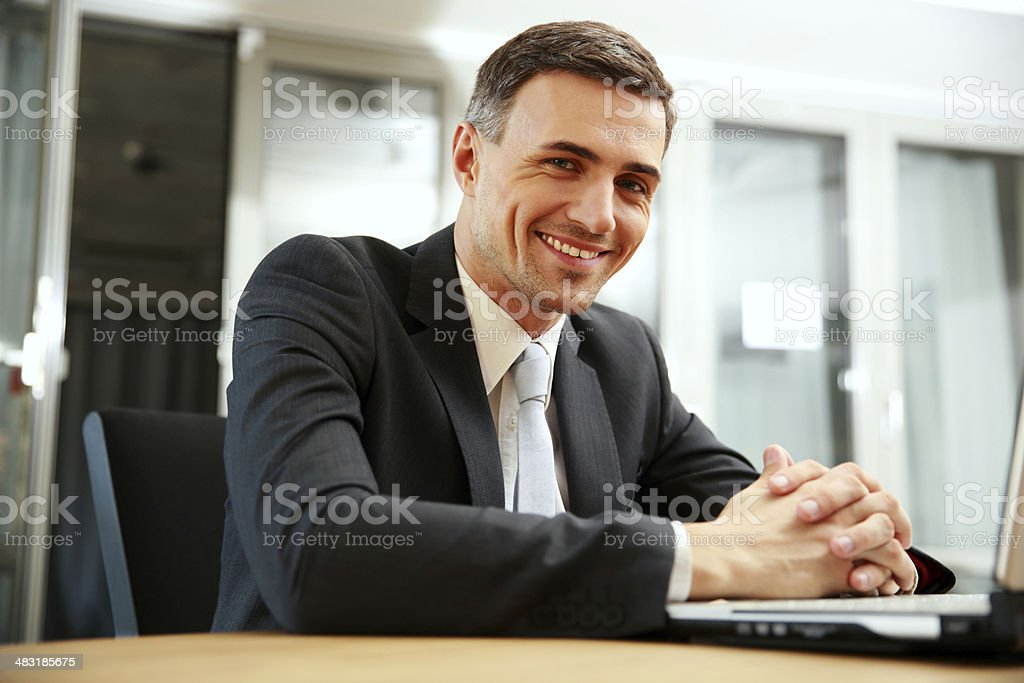businessman sitting with laptop stock photo