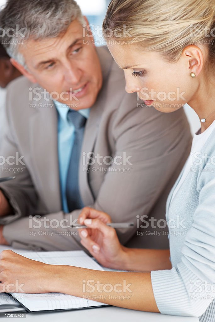 Businessman sitting with secretary planning a meeting stock photo