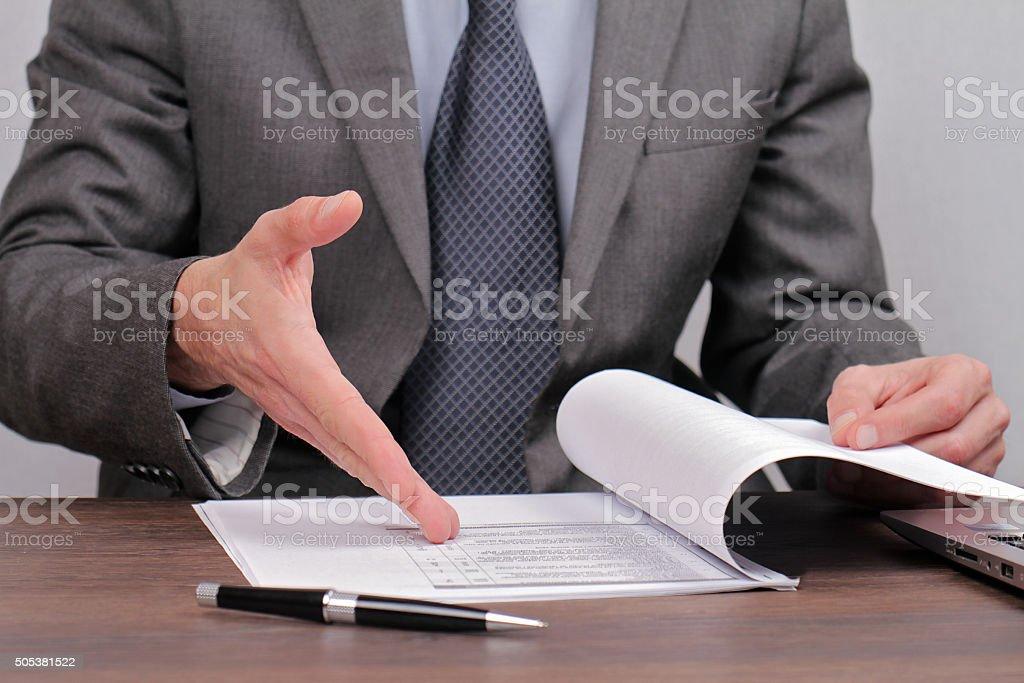 Businessman skeptical reading dokument stock photo