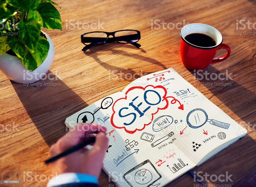Businessman Sketching About SEO Concept stock photo
