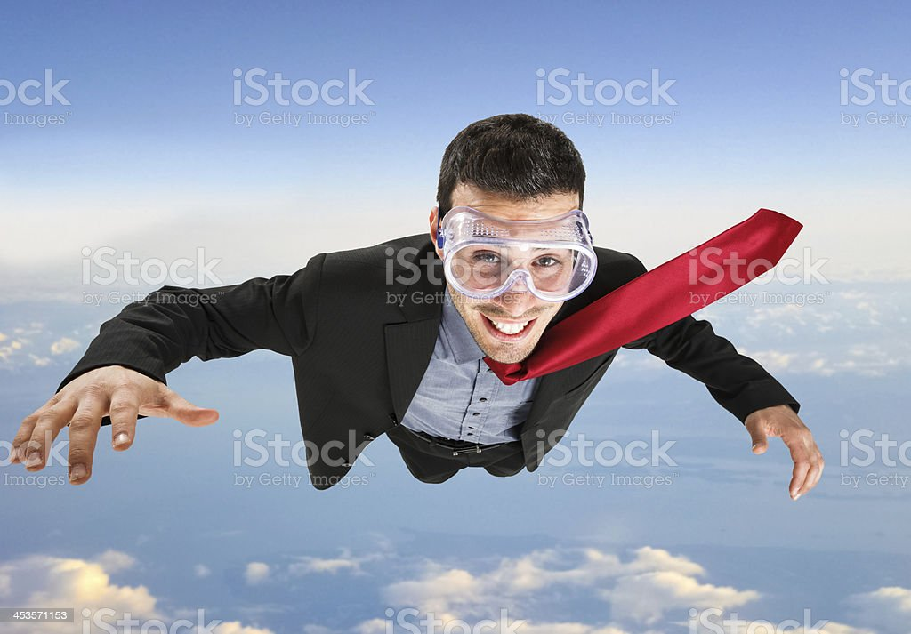 Businessman skydiving royalty-free stock photo