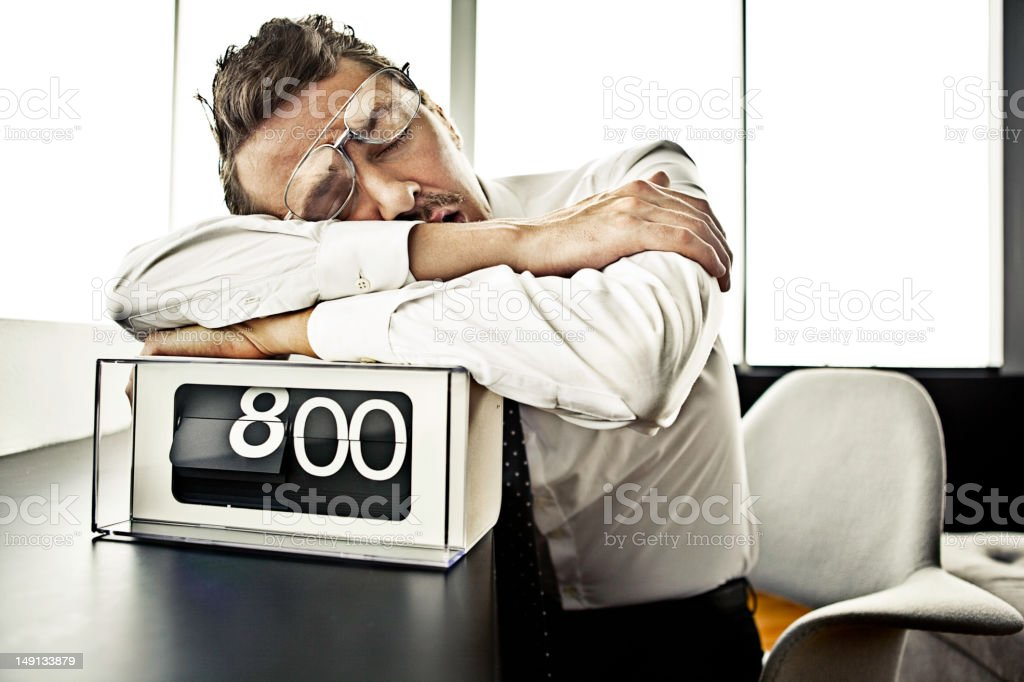 Businessman sleeping at the office stock photo