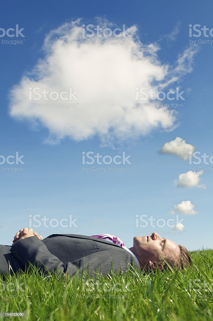 Businessman Sleeping Dreaming with Thought Bubble Clouds stock photo