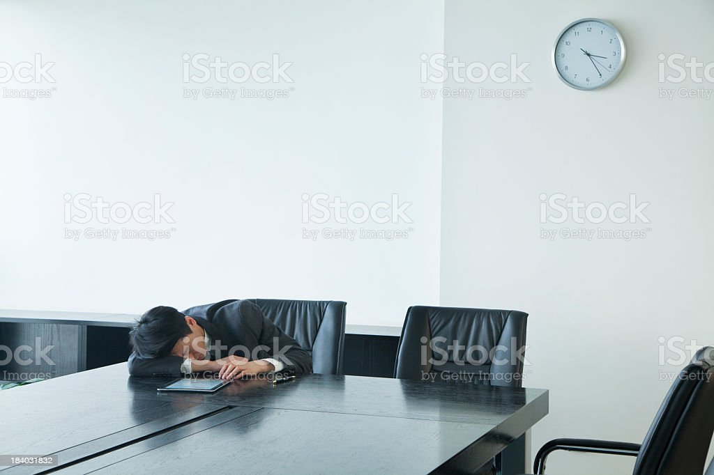 Businessman sleeping in office room royalty-free stock photo