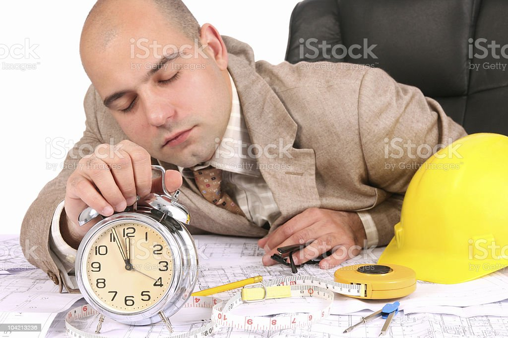 businessman sleepy with architectural plans royalty-free stock photo