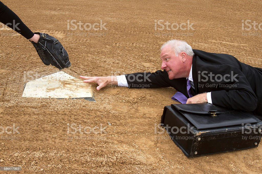 Businessman Sliding for Home stock photo