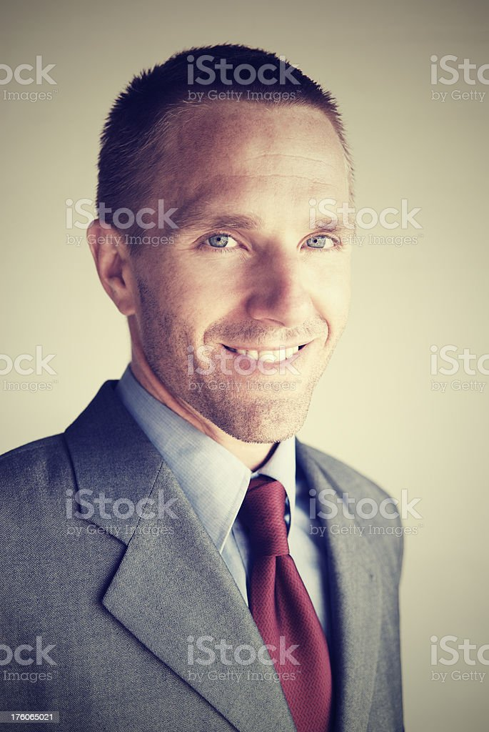 Businessman Smiles for a Portrait in Burgundy Tie Gray Suit royalty-free stock photo