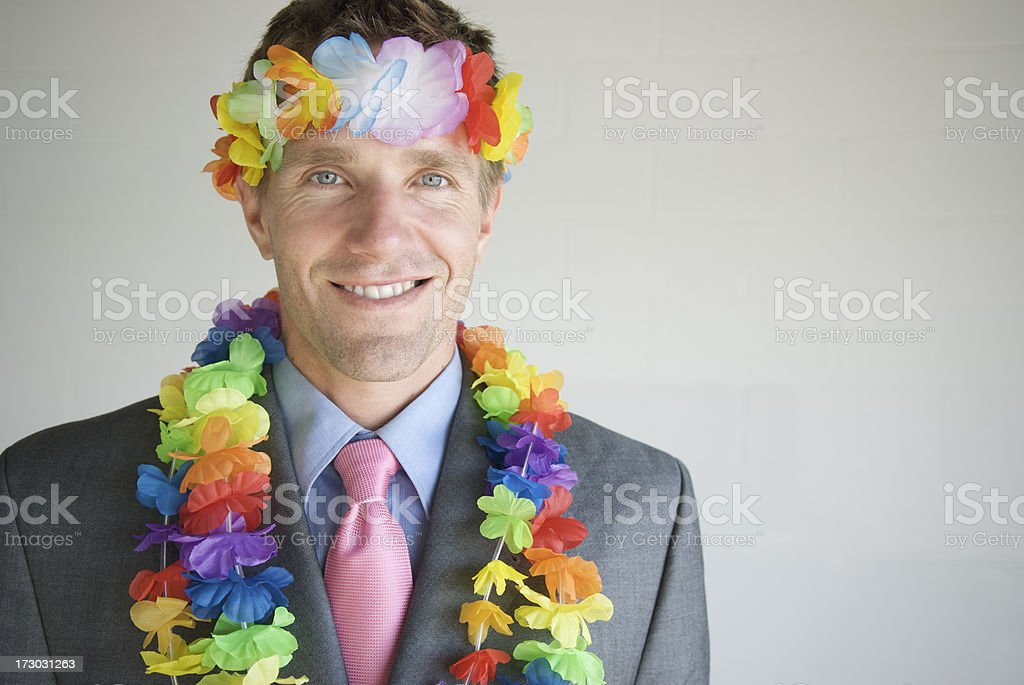 Businessman Smiles with Flower Headband and Lei royalty-free stock photo
