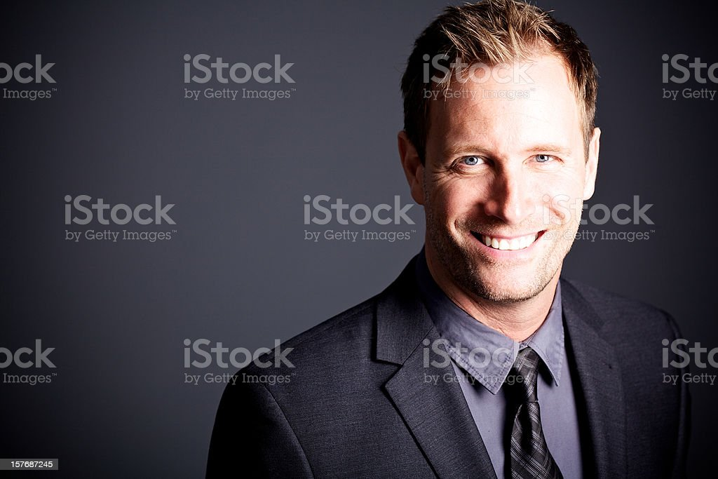 Businessman smiling and looking at camera royalty-free stock photo